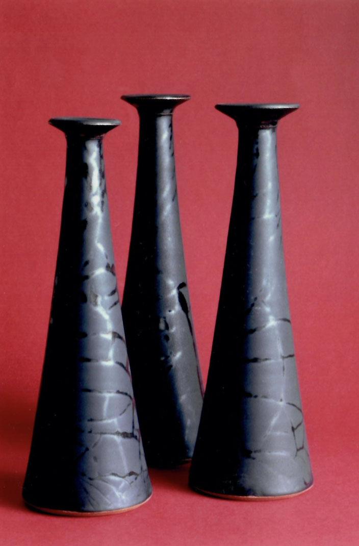 2006 vases turned, black glaze