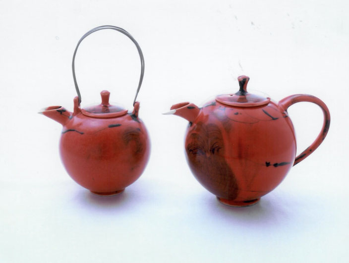 2006 Tea set with silver and steel, twisted, red glaze with black craquelure