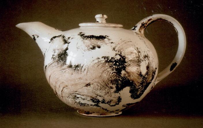 2002 tee pot turned, white glaze with black craquelé