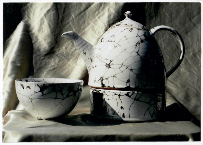 2002 tableware turned, white glaze with black craquelé