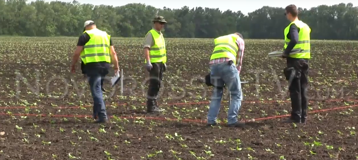 Collecting soil samples at alleged launch site. Still from video Novorossiya TV