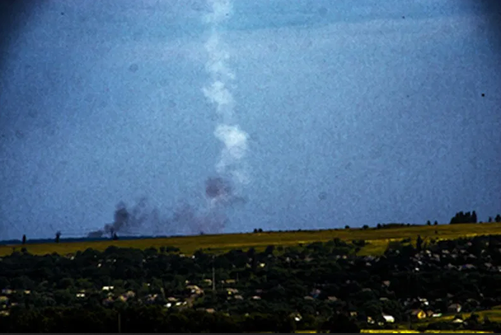 Black smoke inside the white plume becomes visible when the contrast is increased.