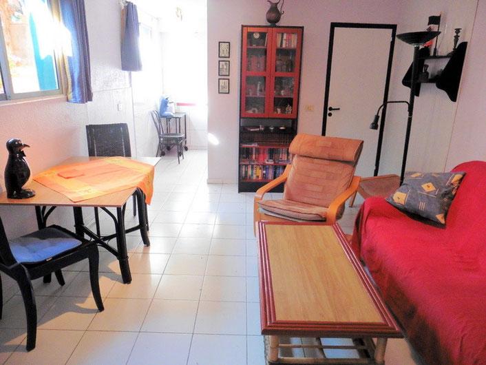 Wohn- und Esszimmer mit offener Küche