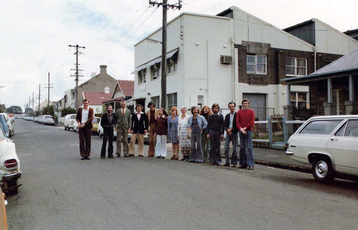 Staff standing in Elliott Street Balmain with Meher Handicrafts in the background. It later became Meher Australia and closed in the early 1990s.