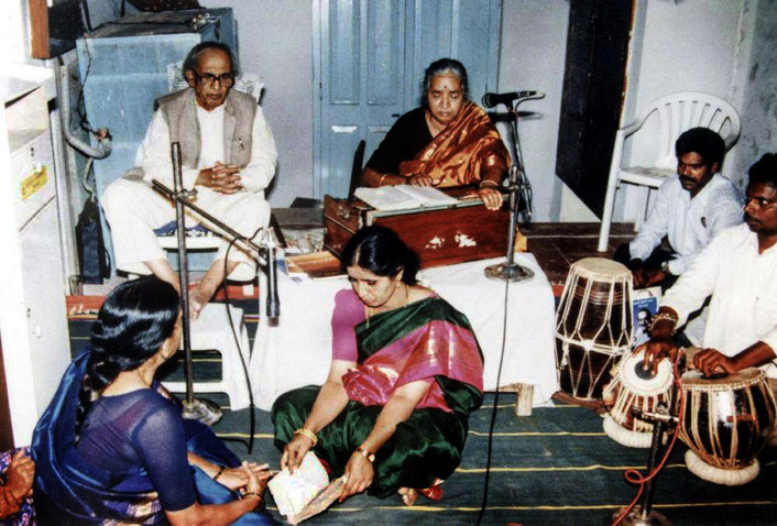 Photo courtesy of Nan Wicker. Madhusudan is accompanied by his wife Subhuddra on harmonium