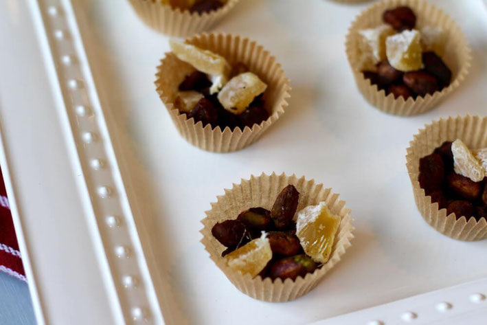 Love candied pecans? Then you'll also love these candied pistachios. The candied nuts recipe is healthy and easy—and a great pistachio dessert. #pistachios #nuts #glutenfree #chocolate #vegetarian #ginger #healthyfat