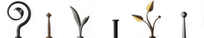 Endstücke für Vorhangstangen aus Eisen : Enkappe, Folia - teilweise mit Blattgold, Prima, Filix, Punta und Canna in den Farben rost, schwarz und graphit