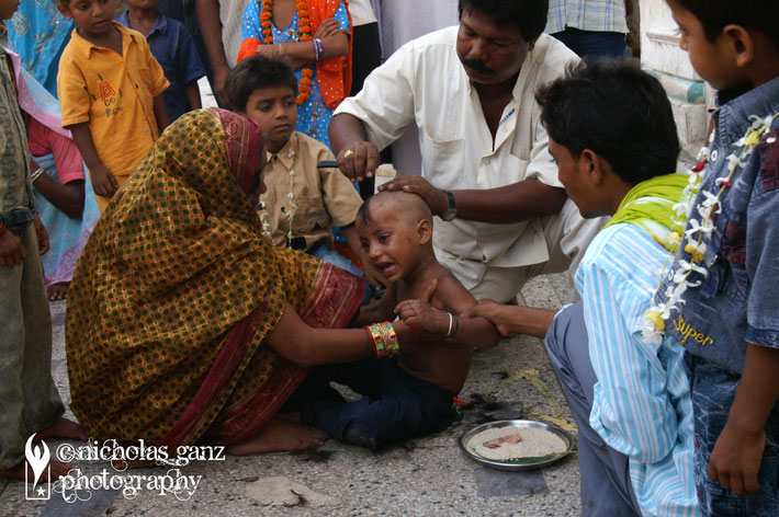 A young boy gets his hair shaved at the Janaki Mandir temple in Janakpur. It is an initiation ceremony to become a man.
