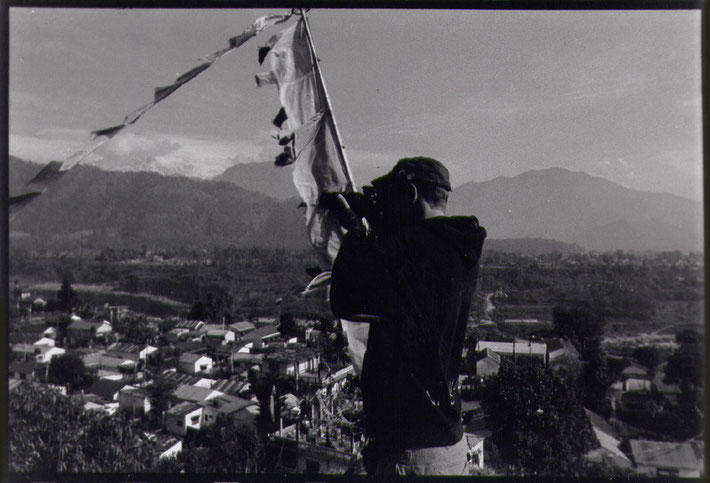 Nicholas Ganz photographing at the Tibetan refugee-settlement of Tashi Palkhiel in Nepal 2012.