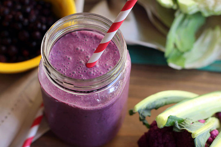 Amp up your smoothie with veggies? With this wild blueberry and purple cauliflower smoothie, you won't taste the difference! The color is beautiful and best of all, takes minutes to make! #vegansmoothie #veganrecipes #cauliflowerrecipes #plantbaseddiet