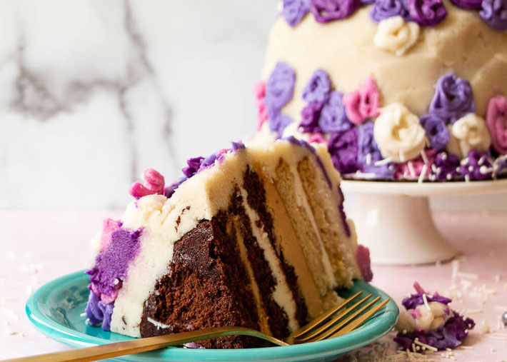 Looking for a wedding cake recipe? This homemade vegan wedding cake is also a gluten free wedding cake recipe. It's one of the best 5 layer cake ideas with flowers! #weddingcake #vegancake #veganwedding #glutenfreecake #glutenfreewedding #dairyfreecake