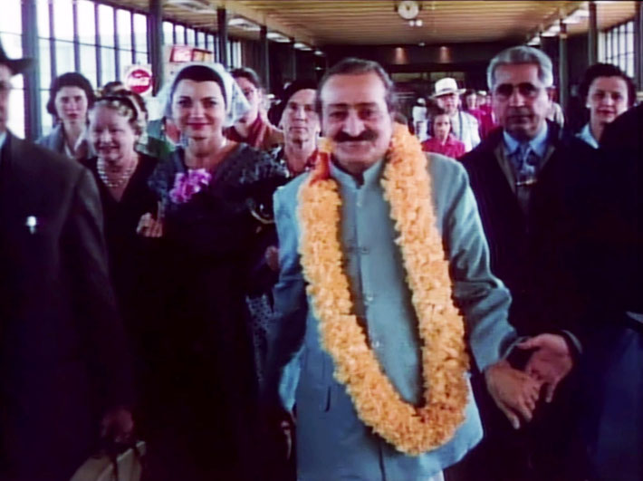 1956 ;  Meher Baba with his entourage at San Francisco Airport.  Image captured by Anthony Zois from a film by Sufism Reoriented.
