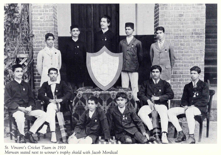 Late 1910 : Merwan Irani seated with the St.Vincent's Cricket Team with the winner's trophy. Image of Lord Meher V.1 - p. 179.