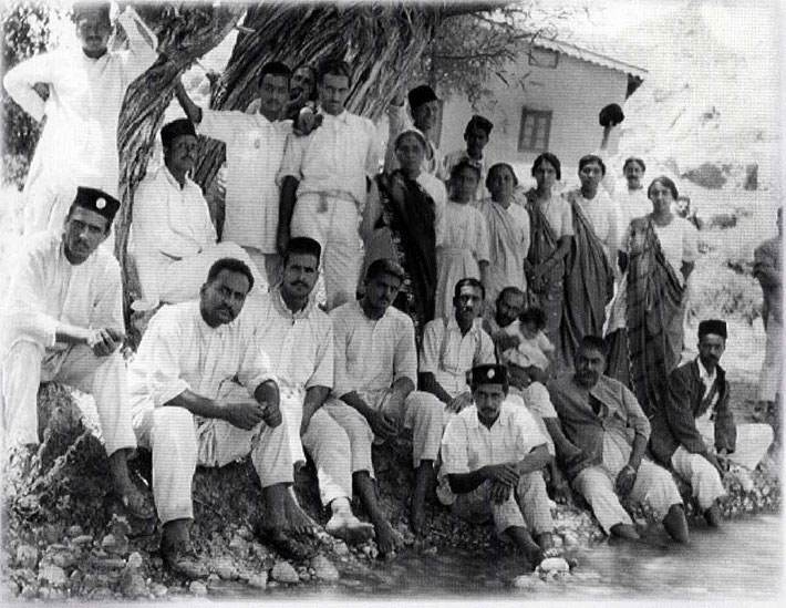 21st June, 1923 - Mt. Urak, Quetta ( then British W. India ) ; Adi K is seated with his feet in the water wearing a dark hat. Gulmai ( his mother ) is wearing dark sari amoungst Baba's men mandali. Courtesy of Glow Int. magazine -Fall 2018.