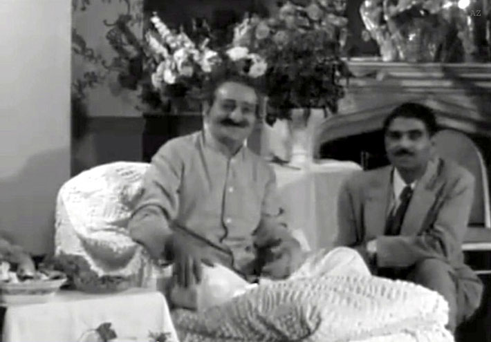 Meher Baba and Eruch Jessawala greeting visitors
