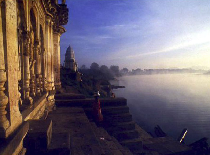 Misty dawn on the Narmada River and Bathing Ghats at Mandla, India