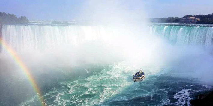 Horseshoe Falls at Niagra Falls, Canadian side view with Maid of the Mist on the water.