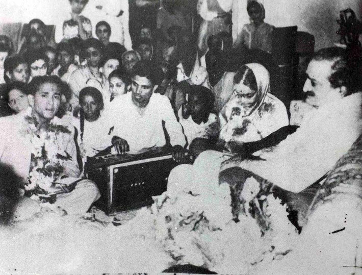 1959, Guruprasad, Pune, India. Meher Baba is officiating at Madhusudan ( front left ) and Subhadra  ( lady seated next to Baba ) their wedding ceremony.  Pratap Ahir is playing the harmonium.