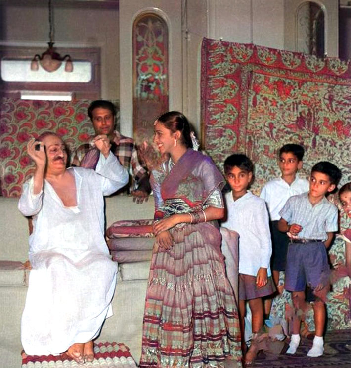 1960 Guruprasad, India. The Mistry boys observing Meher Baba's interactions with a visitor. Colorized by Meher Bheem.
