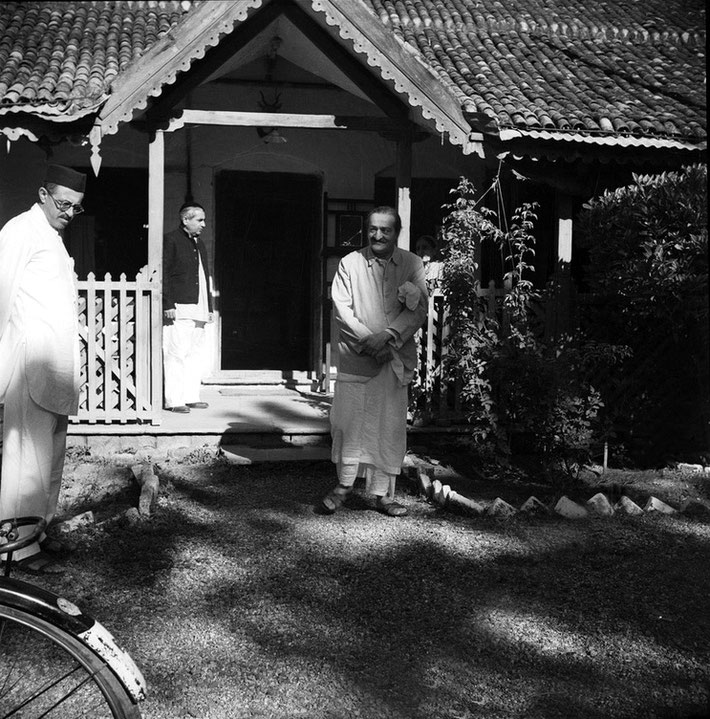 1960s - Khushru Quarters, Ahmednagar. Baba looking at Feram with Adi K. behinds them.