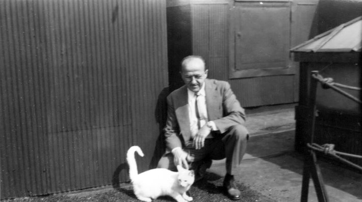 Fred and cat on New York rooftop. Courtesy of Meher Archives