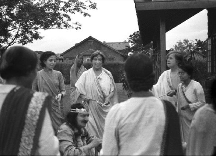 1938 - Nadine standing behind Baba whilst they celebrated Krishna's birthday, India. Mani Irani  ( left ).