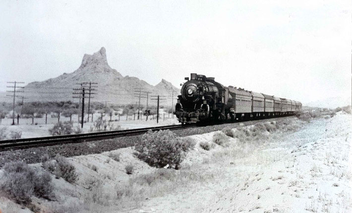 "1930s ; The ""Sunset"" passing Picacho Peak landmark west of Tucson, AZ., on the ""Golden State Limited"" line.  Image from ""Classic Trains Collection"" magazine. Courtesy of Larry Karrasch."