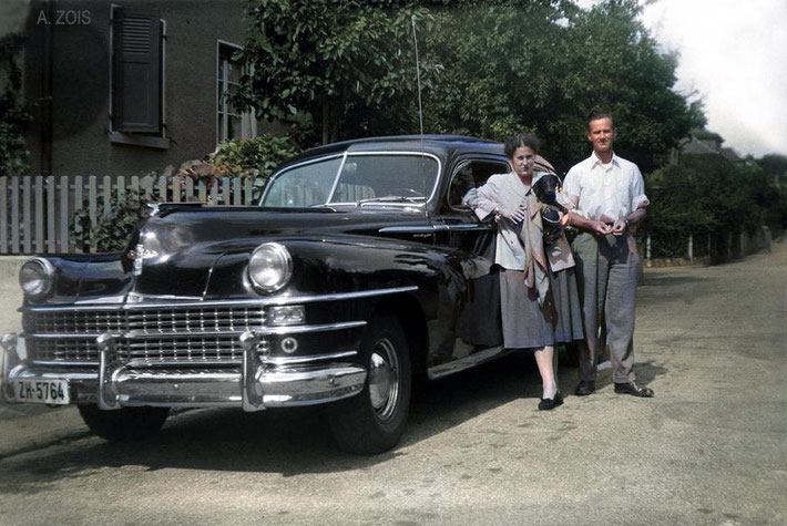 Irene Billo leaning on her Chrysler car with Dr. Willian Donkin standing nearby. This is the car that Baba travelled throughout Switzerland. Image colourized by Anthony Zois.