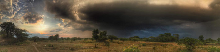 Photo by Andrew Radford, capturing a storm cloud rolling into Meherabad