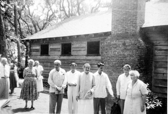 1956 ; Baba with his men mandali and Elizabeth Patterson outside the Barn. The man on the far left is Dr. Birdie and the lady in the floral dree is Edith Bradbury.