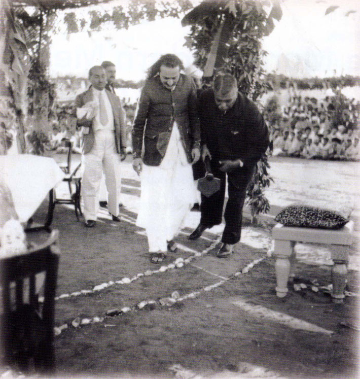 17th December 1939 : Meher Baba laid the Foundation. Bhyrumshaw D. Jessawala ( Papa ) is assisting Baba, with Kaka Baria looking on.