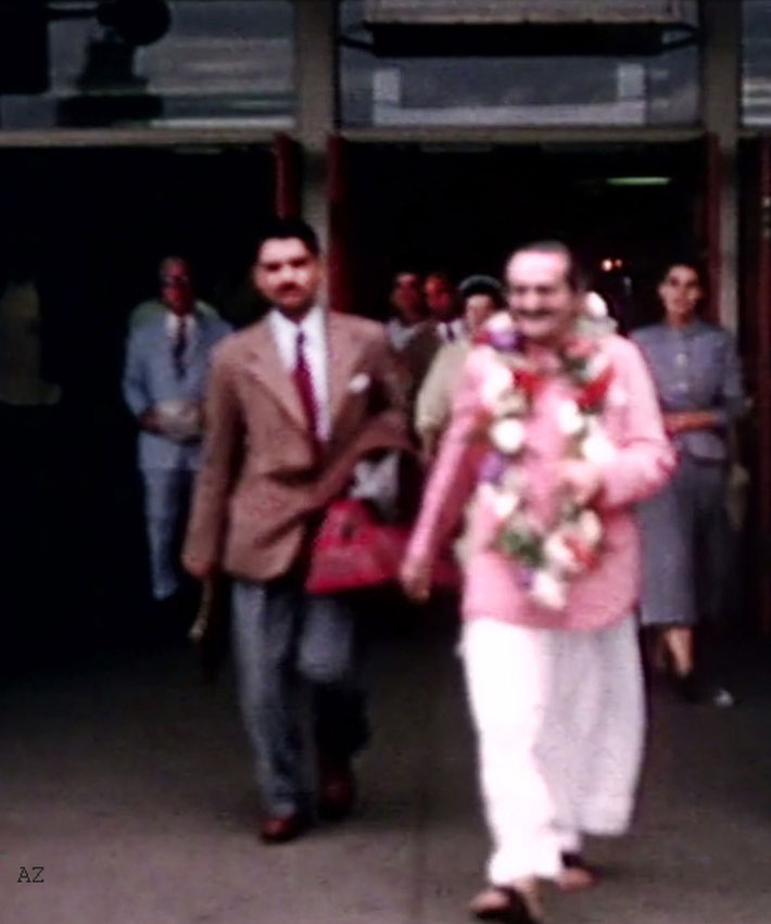 20th July, 1956 : Meher Baba outside the airport terminal with Eruch Jessawala. Image captured by Anthony Zois from a film by Sufism Reoriented.
