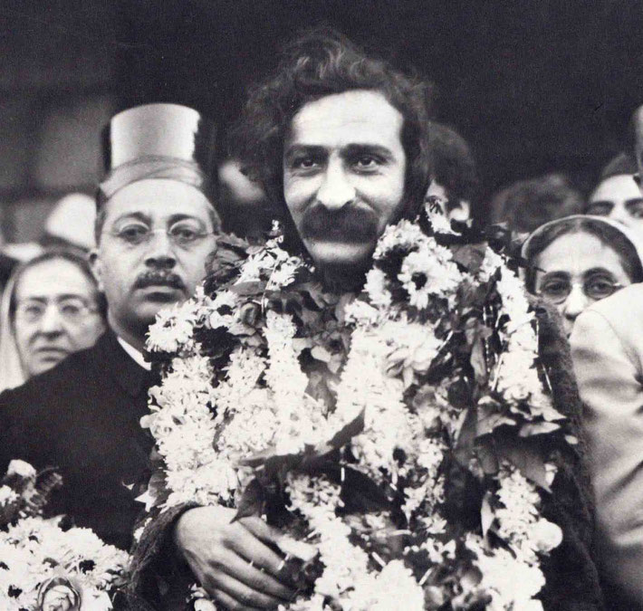 LP : 1932  -  Meher Baba being greeted on his return back to Bombay in 1932. His mother Shireen Irani is on his left-rear and Gulmai Irani on his right-rear