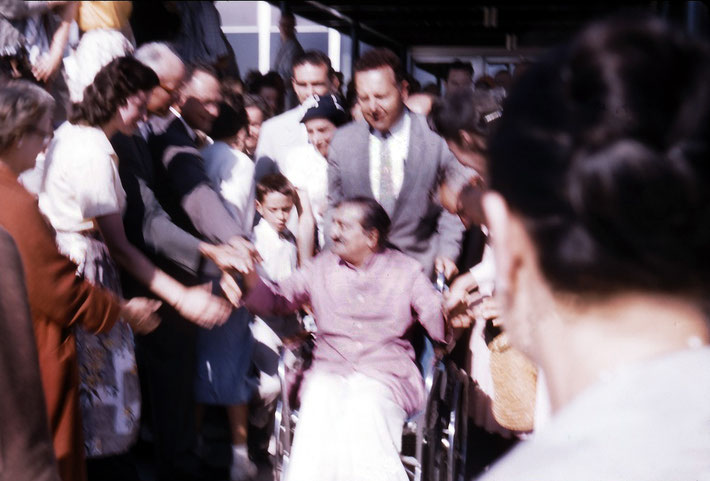 1958 : Meher Baba arriving at Wilmington Airport from New York City. Larry is next to Baba and with Lud Dimpfl pushing the wheelchair.