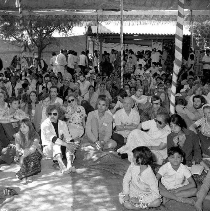 1973 Amartithi : Mostly the Australian Meher Baba group during the celebrations at Upper Meherabad. May is sitting behinf Francis Brabazon, centre-right. Image courtesy of Raine Eastman-Gannett