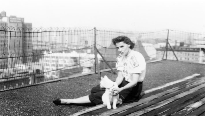 Ella and cat on New York rooftop. Courtesy of Meher Archives