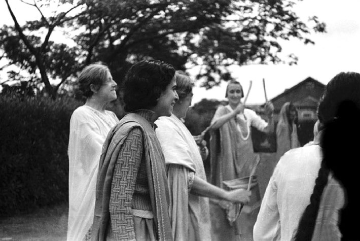 1938- Norina centre rear holding up sticks celebrating Krishna's birthday in India.  Helen Dahm, Mani Irani & Nadine Tolstoy ( left). Mansari Desai with back to camera. Courtesy of MN Publ.