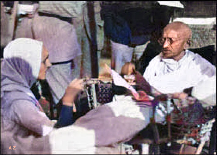 Gandhi reading on deck while travelling on the SS Rajputana. Image colourized by Anthony Zois.