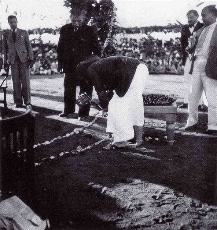 17th December 1939 : Meher Baba breaking ground at the Foundation. Bhyrumshaw D. Jessawala ( Papa ) and  Kaka Baria looking on.