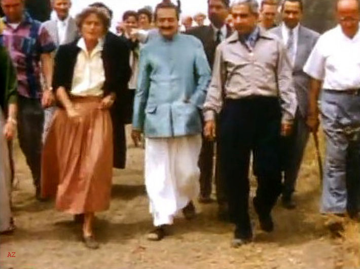 1956 ; Meher Baba being shown the Meher Mount property with caretaker Agnes Baron on the left and Adi K. Irani on Baba's right.  Image captured by Anthony Zois from a film by Sufism Reoriented.