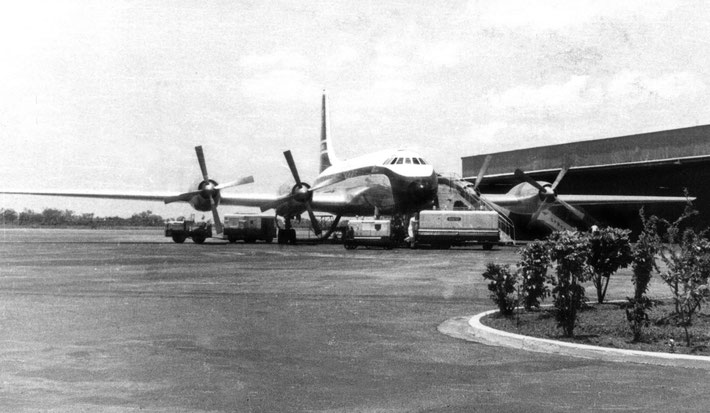 "1958 : Darwin's Civil Airport with a BOAC ""Britannia""  class airliner on a refuelling stop."