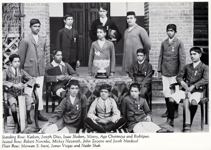 Late 1911 : Merwan Irani seated with the St.Vincent's Cricket Team with the winner's trophy . Image enhanced by Anthony Zois. Image courtesy of Lord Meher V.1 - p. 178