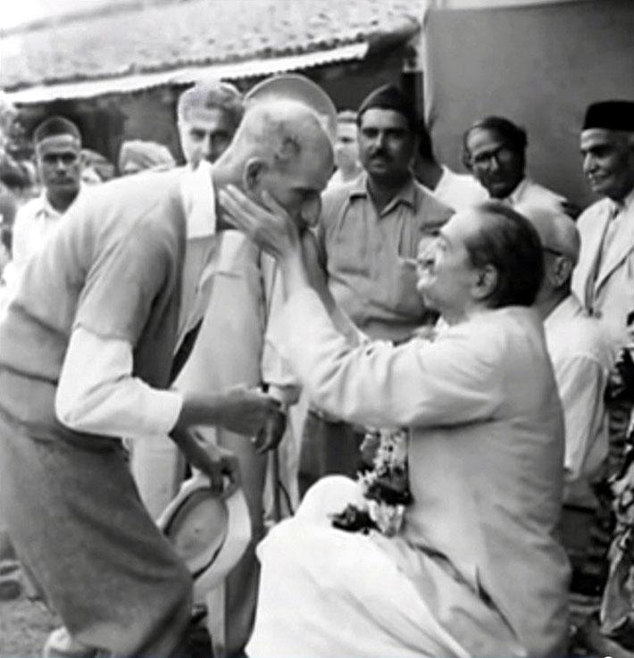 September 1954 :  Kumar is standing far rear of Meher Baba caressing Fred Mark's face.