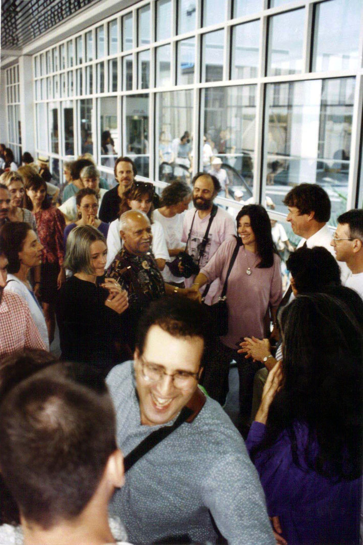 1990s :  Meher Baba's male mandali - Bhau Kalchuri arriving in Myrtle Beach greeted by the local group. Image courtesy of Susan White.