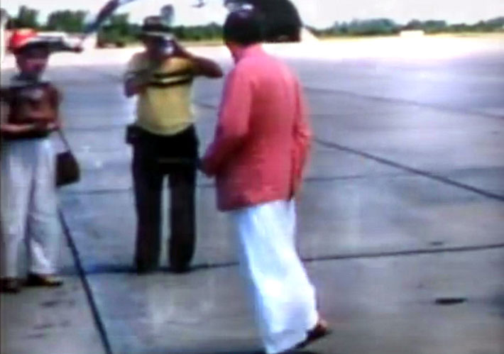 1956 : Joseph taking a photo of Baba arriving at Wilmington Airport, NC.