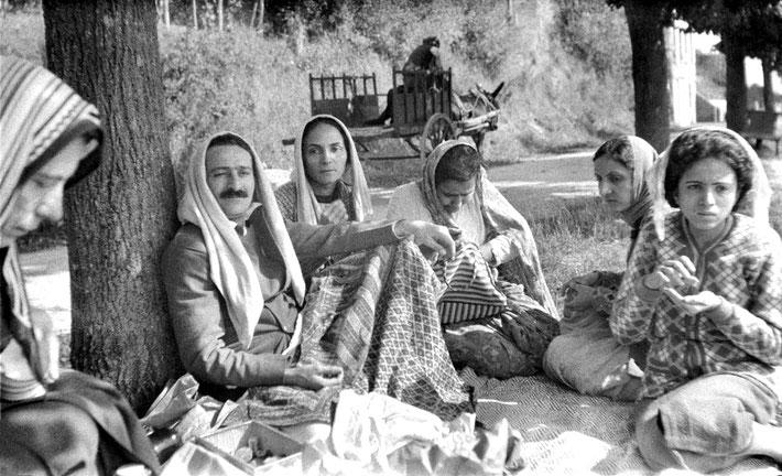 1937 : Having lunch on the road to Paris. Full image. ( L-R ) Kitty Davy, Meher Baba, Mehera Irani, Naja Irani, Khorshed Irani & Baba's sister Mani Irani.