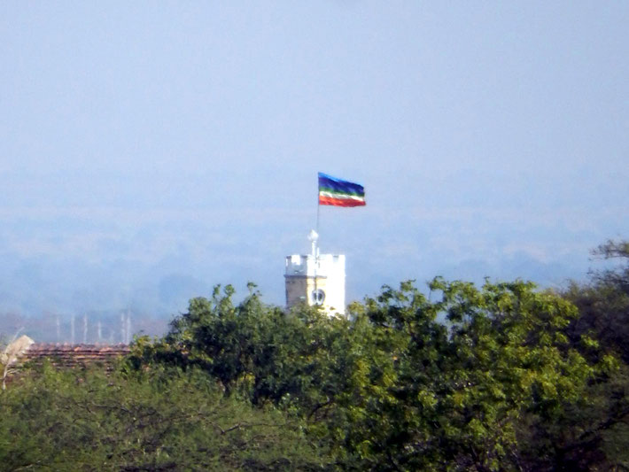 Meher Baba's flag flying at the Tower on Meherabad Hill.