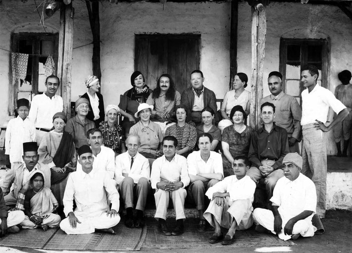 1937 : The group photo shows Meher Baba with his Eastern & Western disciples in Meherabad, India.