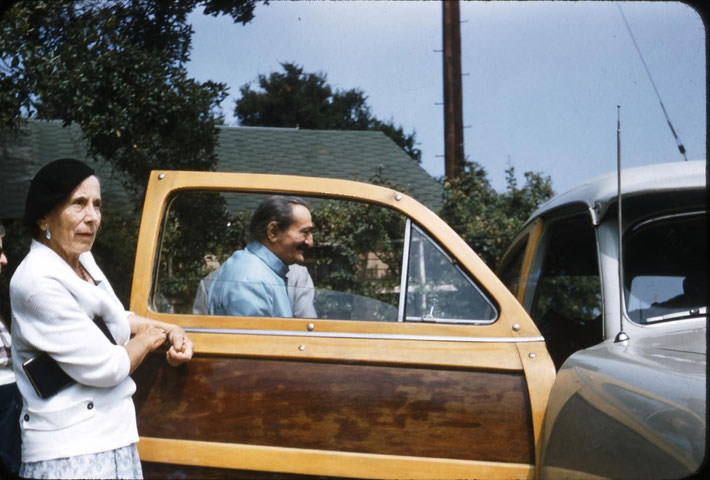 San Francisco - 1950s . Kitty Davy holding the door open for Meher Baba. Image courtesy of the Shaw Family photo collection.