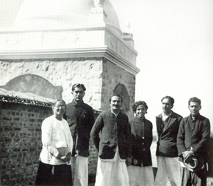 Meher Baba & his family standing near his Tomb at Upper Meherabad, India. Photo courtesy of Lord Meher - 1st Edition  page 2316